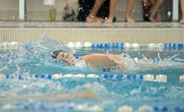 RB's varsity swimmer Leah Harazin competes in the 100-yard freestyle on Thursday, Oct. 12, 2017, during a girls swim meet against Chicago Latin at Riverside-Brookfield High School. (Alexa Rogals/Staff Photographer)