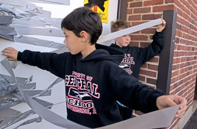 Students use duct tape to tape principal Peter Gatz to a wall on Oct. 20, at Central Elementary School in Riverside. | Alexa Rogals/Staff Photographer