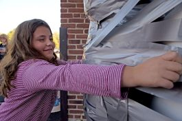 Students tape up Laura McMahon, a fifth grade teacher, on Oct. 20, at Central Elementary School in Riverside. | Alexa Rogals/Staff Photographer