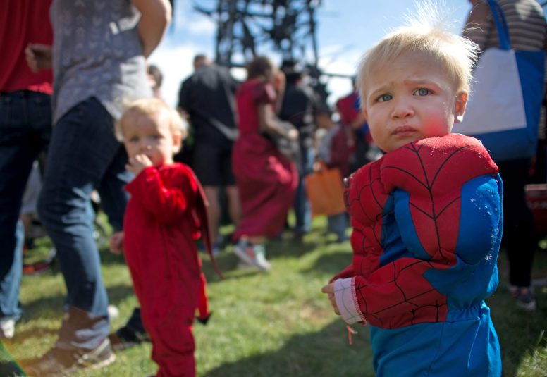 Children dressed up in Halloween costumes walk around the park on Oct. 21, during the Boo at the Zoo event at Brookfield Zoo. | Alexa Rogals/Staff Photographer