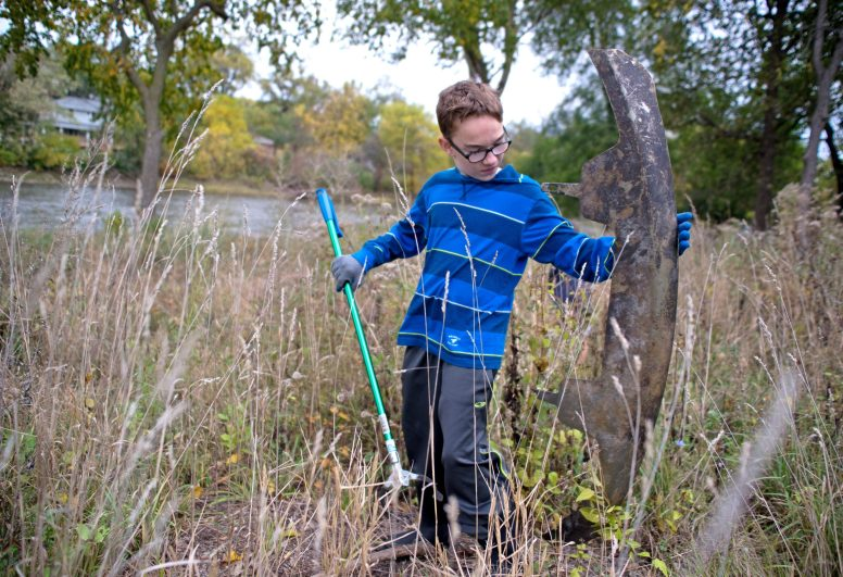 Jonathan Obuchowski, 13, and fellow members of Boy Scout Troop 24 pick up trash in the forest preserve area along the south banks of the Des Plaines River during the 42nd Annual Hofmann Dam River Rats Fall Clean-up on Oct. 21. | Alexa Rogals/Staff Photographer