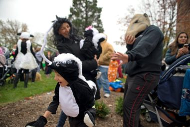 "A participant dressed as a skunk pretends to ""spray"" attendees on Oct. 28, during the Monsters on Main Street costume contest at Grossdale Station in Brookfield. 