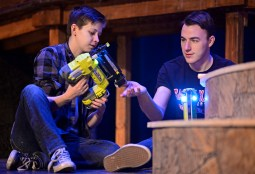 """Crew member Andrew Pekny, left, and set designer John Gorski, both seniors, fix up a portion of the set on Nov. 4, during rehearsals for Shakespeare's """"A Midsummer Night's Dream"""" in the auditorium at Riverside Brookfield High School.   Alexa Rogals/Staff Photographer"""