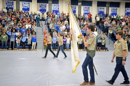 Students and faculty stand as the colors are retired on Nov. 10, during the annual Veteran's Day assembly inside the gymnasium at Riverside Brookfield High School. | Alexa Rogals/Staff Photographer