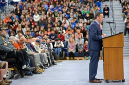 John Fields speaks to the audience on Nov. 10, during the annual Veteran's Day assembly inside the gymnasium at Riverside Brookfield High School. | Alexa Rogals/Staff Photographer