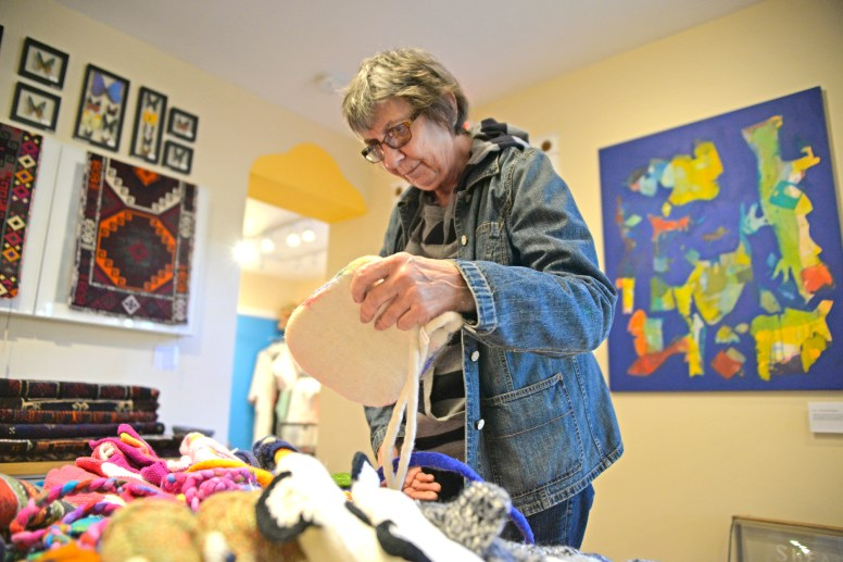 Anita Hunt, of Brookfield, looks through a selection of handbags for sale at Laura Atwood Studio Beads and Trading Company on Broadway Avenue on Nov. 25, which was Small Business Saturday to kick off the holiday shopping season. | Alexa Rogals/Staff Photographer