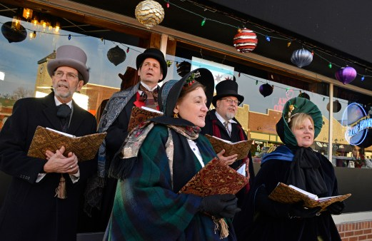 Brookfield's annual Holiday Walk on Dec. 2 featured a full afternoon's worth of events and activities at the village hall, in the Grand/Prairie district and at Eight Corners. The Canterbury Carollers sing outside of the Brookfield Ale House. | ALEXA ROGALS/Staff Photographer