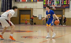LT's Nick McColgan (4) dribbles the ball down court and looks to pass on Friday, Dec. 8, 2017, during a varsity basketball game against OPRF in the field house at Oak Park and River Forest High School. | ALEXA ROGALS/Staff Photographer