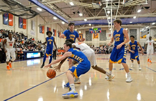 LT's Nolan Niego (3) fights for the ball after a rebound on Friday, Dec. 8, 2017, during a varsity basketball game against OPRF in the field house at Oak Park and River Forest High School. | ALEXA ROGALS/Staff Photographer