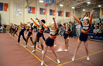 The OPRF squad performs a routine on Friday, Dec. 8, 2017, during a varsity basketball game against Lyons Township in the field house at Oak Park and River Forest High School. | ALEXA ROGALS/Staff Photographer