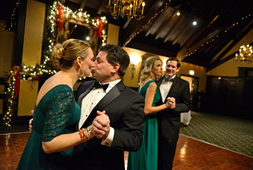 Jennifer Hepker, left, and Justin Royer kiss while dancing together on Dec. 10, during the Riverside Dancing Club's Winter Dance at Edgewood Valley Country Club in La Grange. | Alexa Rogals/Staff Photographer