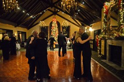 Attendees join the dance floor and begin dancing on Dec. 10, during the Riverside Dancing Club's Winter Dance at Edgewood Valley Country Club in La Grange. | Alexa Rogals/Staff Photographer