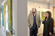 John Gosciejew, left, and Shannon Roman Gosciejew, both of Brookfield, look at the different art displayed on Friday, Jan. 5, during the opening night and first exhibition at Compassion Factory Art Gallery in Brookfield. | Alexa Rogals/Staff Photographer