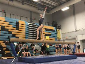 RBHS freshman Savannah Bishop performing a routine on beam. (Courtesy Karyn Domzalski)