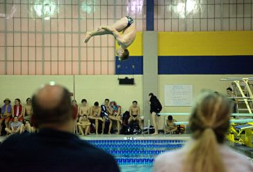 LTHS senior diver Sam Dillon performs for the judges on Friday, Jan. 19, 2018, during a swim and dive meet against OPRF at Lyons Township High School South Campus in La Grange, Ill. (Alexa Rogals/Staff Photographer)
