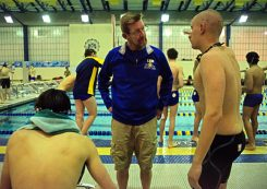 LTHS head coach Scott Walker talks with one of his swimmers on Friday, Jan. 19, 2018, during a swim and dive meet at Lyons Township High School South Campus in La Grange, Ill. (Alexa Rogals/Staff Photographer)