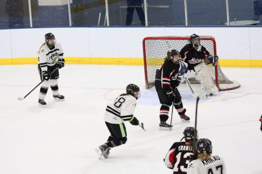 Fenwick forwards Ellie Kaiser (#18), center, and Sam Schak (53), left, wait for a centering pass with defenseman Megan Krikau pressing from behind. (File photo)