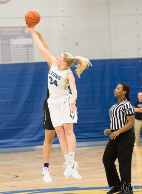 Lyons Township senior Emma Fink, a three-sport star, has impacted the Lions' basketball team with her solid play offensively and defensively. (Courtesy Deb Wesley Photography)