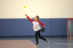 A player trying out for the softball minor division throws the ball on Feb. 17, during assessments in the field house at Riverside Brookfield High School. | Alexa Rogals/Staff Photographer