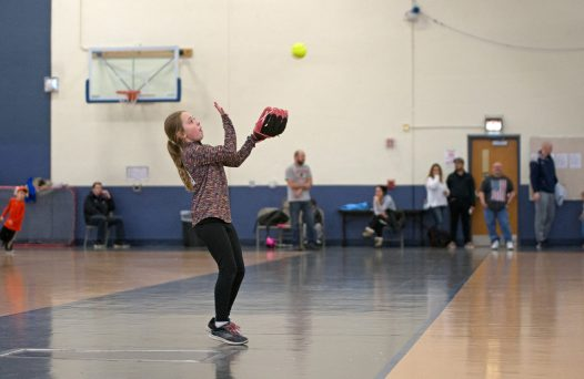 An attendee catches a pop up on Feb. 17, during assessments in the field house at Riverside Brookfield High School. | Alexa Rogals/Staff Photographer
