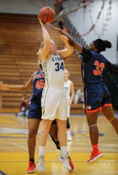 Emma Fink excels in three sports at Lyons Township. The Landmark first-team player averaged almost a double-double in basketball. (Courtesy Deb Wesley Photography)