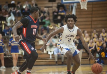 LTHS guard Tyrese Shines averaged 16.5 points this season. He played particularly well in game a against Glenbard West, scorching the Hilltoppers for 29 points on 11 of 18 shooting. (Alexa Rogals/Staff Photographer)