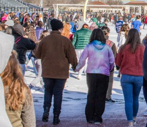 Students protest gun violence at the Riverside-Brookfield High School walkout on March 14. (Photo by Diana Meeks| Contributor)