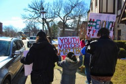 Tallgrass Sudbury School students carry signs while marching through downtown Riverside during the National Student Walkout protesting gun violence on March 14. (Photo by Helen Tornquist | Contributor)