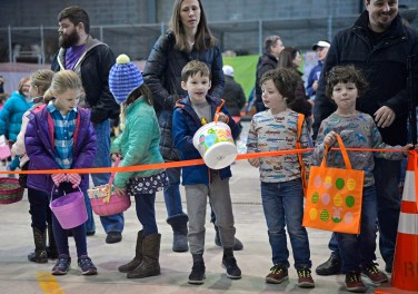 Children wait behind the line to get the eggs on March 24, inside the Riverside Public Works facility in Riverside Lawn for the village's annual Easter Egg Hunt. | Alexa Rogals/Staff photographer