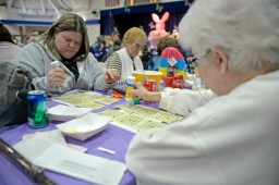 Attendees stamp their bingo cards on March 23, during Bunny Bingo at the Village Commons in North Riverside. | Alexa Rogals/Staff photographer