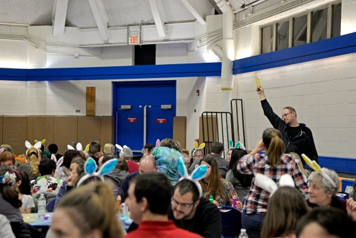 An attendee holds up a winning bingo card on March 23, during Bunny Bingo at the Village Commons in North Riverside. | Alexa Rogals/Staff photographer