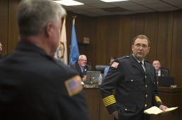 Incoming fire chief Mark Duffek, right, praises outgoing fire chief Patrick Lenzi for his work on April 23, during a Village Board meeting at Brookfield Village Hall. | Alexa Rogals/Staff Photographer