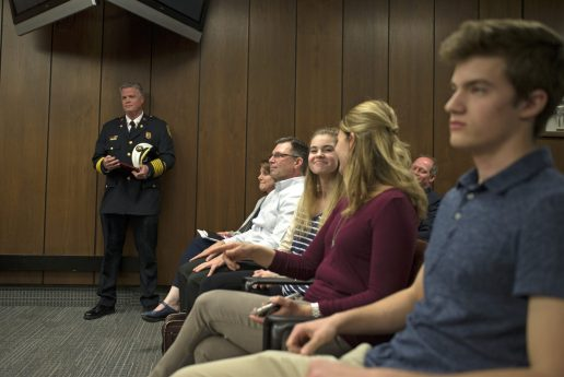 Outgoing fire chief Patrick Lenzi stands near his family on April 23, during a Village Board meeting at Brookfield Village Hall. | Alexa Rogals/Staff Photographer