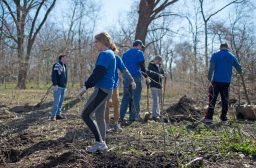 Students clear out debris and garbage from an area where they will be digging holes to plant pecan trees on April 28, during the Riverside Brookfield High School Day of Service at Indian Gardens in Riverside. | Alexa Rogals/Staff Photographer