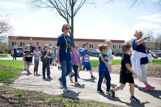 First graders from Brook Park School walk to the park together during their turn outside for a walkathon, one of several events planned by the Brook Park Council to raise funds for a new playground at the soon-to-be expanded school. | Alexa Rogals/Staff Photographer