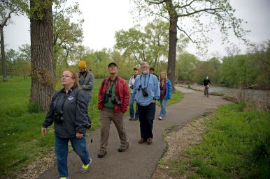 A group walks along a path looking for birds on May 12, during a bird watching event as part of World Migratory Bird Day along the Des Plaines River in Riverside. | Alexa Rogals/Staff Photographer