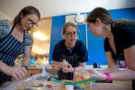 Faculty team members (from left) Johannah Tomita, Amy Beggs and Jackie Sprague are hard at work designing their cake. | Alexa Rogals/Staff Photographer