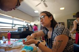 Faculty member Johannah Tomita, right, discusses what the cupcakes should look like with Amy Beggs on May 16, during the annual cupcake war decorating competition at Komarek School in North Riverside. | Alexa Rogals/Staff Photographer