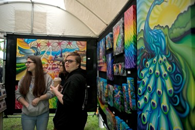 Visitors eye the work of artist Peter Thaddeus on May 19, during the annual Riverside Arts Weekend, at Guthrie Park in Riverside. | Alexa Rogals/Staff Photographer