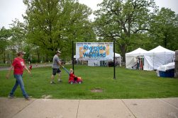 Attendees walk down the sidewalk on May 19, during the annual Riverside Arts Weekend, at Guthrie Park in Riverside. | Alexa Rogals/Staff Photographer