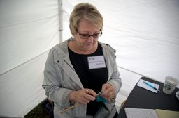 Artist Ellen Grenier Bevill knits a piece of fabric in her booth on May 19, during the annual Riverside Arts Weekend, at Guthrie Park in Riverside. | Alexa Rogals/Staff Photographer