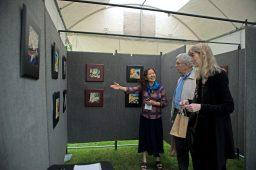 Ceramics artist Zu Yuy shows attendees the different art pieces she has for sale on May 19, during the annual Riverside Arts Weekend, at Guthrie Park in Riverside. | Alexa Rogals/Staff Photographer