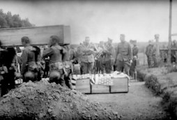 U.S. Army troops carry the coffins holding the bodies of their dead comrades into the French Military Cemetery in Baccarat on May 28, 1918 and line them up for burial.   U.S. Army Signal Corps movie still, courtesy of National Archives