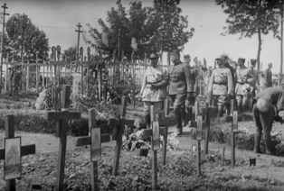 Top commanders, including Major Gen. Charles T. Menoher, Col. Douglas MacArthur and French generals Dupont and Penet arrive to pay their respects at the Baccarat cemetery where the 42nd Division's dead were laid to rest on Decoration Day, May 30, 1918.   U.S. Army Signal Corps movie still, courtesy of National Archives