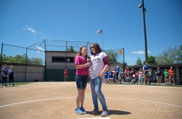 Ginny, left, and Maggie Redmond sing the National Anthem. | Alexa Rogals/Staff Photographer