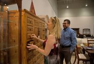 Loyal customers of Divine Consign turned out on June 7 for the store's grand re-opening at their new location in North Riverside. Above, Kate and Burt Klein of River Forest check out a chest of drawers. | Alexa Rogals/Staff Photographer