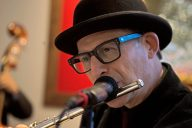 Michael Levin plays the clarinet with his band on June 7, during the grand opening party at Divine Consign on Harlem Avenue in North Riverside. | Alexa Rogals/Staff Photographer