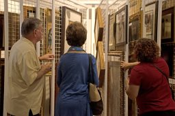 Customers look through different artwork for sale in the store on June 7, during the grand opening party at Divine Consign on Harlem Avenue in North Riverside. | Alexa Rogals/Staff Photographer