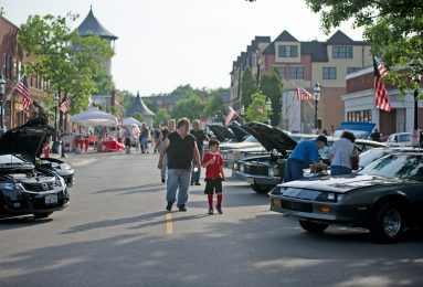 Attendees walk down the road and check out the vehicles displayed on June 7, during the first monthly Cruise Night of the summer in downtown Riverside. | Alexa Rogals/Staff Photographer