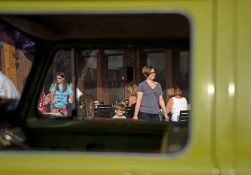 Guests walk passed local shops and check out the show cars parked out front on June 7, during the first monthly Cruise Night of the summer in downtown Riverside. | Alexa Rogals/Staff Photographer